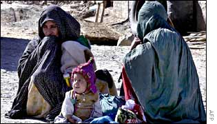 A displaced family outside a refugee camp in Spin Boldak, Afghanistan
