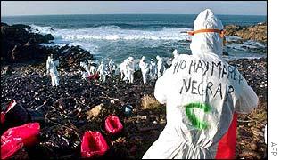 Catalan clean-up volunteer at work on Galician coast