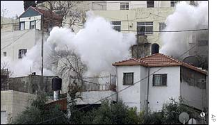 Smoke rises from the home of a suspected Hamas militant being destroyed by Israel