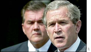 US President Bush, with Tom Ridge behind