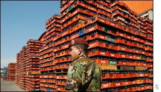 A Venezuelan National Guard soldier walks next to Coca-Cola bottles storage in the Coca-Cola - Panamco bottling plant