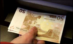 Euros being taken from a cashpoint