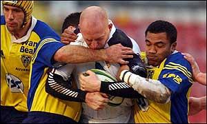 Swansea's Steve Winn is held up by a strong Montferrand defence