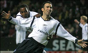 Youri Djorkaeff celebrates his stunning strike