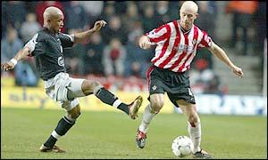 Liverpool's El Hadji Diouf (left) and Southampton's Chris Marsden