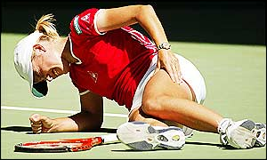 Justine Henin-Hardenne crumples to the ground after being hit by cramp