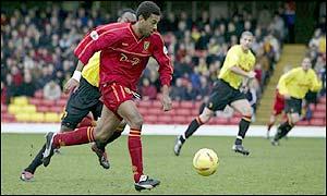 Norwich striker David Nielsen runs clear of the Watford defence