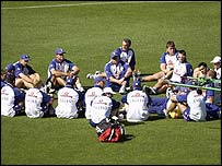 England players sit down during training