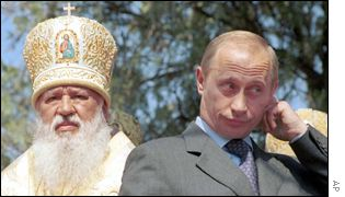 Church official with Vladimir Putin