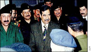Saddam Hussein with bodyguards and son