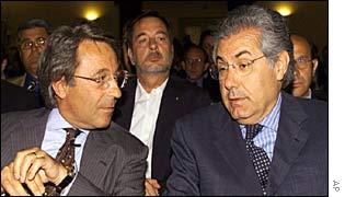 Italian entrepreneurs Emilio Gnutti, left, and former Telecom President Roberto Colaninno