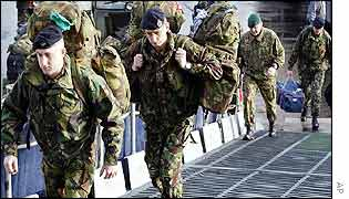 Troops board helicopter carrier HMS Ocean