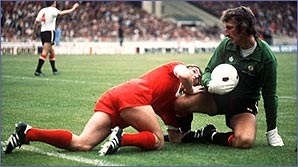 Liverpool's Kenny Dalglish is foiled by Man United's Alex Stepney
