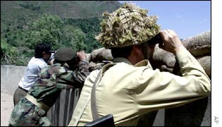 Pakistani soldiers check across the Kashmir Line of Control