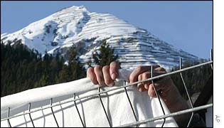 A Swiss soldier setting up barriers in Davos on Monday