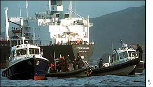 Police move in to arrest Greenpeace activists aboard the Vemanagna