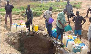 Water hawkers drawing water from well in Abuja