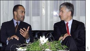 Pierre-Richard Prosper, left, meets with Serbia's prime minister Zoran Djindjic