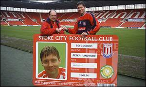 A Stoke City fan picking his ID card up from the club's captain