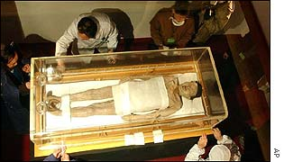 Experts at a museum in China's Hunan province examine a newly-unearthed mummy dating from the Han dynasty