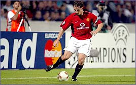 Gary Neville in action in the Champions League for Man Utd