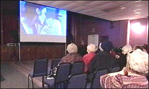 A mobile cinema is set up in a village hall in Shropshire