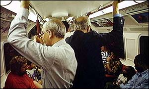 Passengers on a crowded tube train