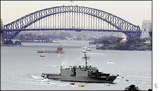 HMAS Kanimbla leaves Sydney with the Harbour Bridge as a backdrop as she sails for the Persian Gulf