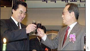 North Korean chief delegate Kim Ryong Song, left, and South Korean Unification Minister Jeong Se-hyun