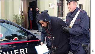 Italian policeman escorts suspect