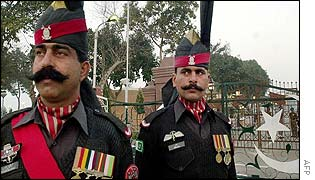 Pakistani troops stand guard at Wagah on the closed border with India