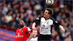 Gary Neville towers over Charlton's Jason Euell for a header