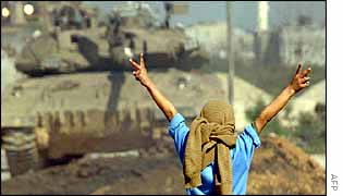 Palestinian boy taunts tank in Beit Hanoun