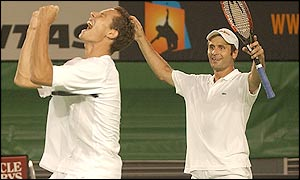 Michael Llodra (left) and Fabrice Santoro celebrate