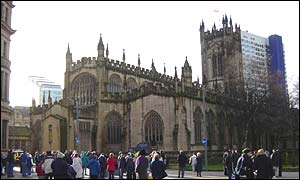 Mourners gather outside Manchester Cathedral