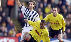 Watford's Micah Hyde tackles Andy Johnson of West Brom