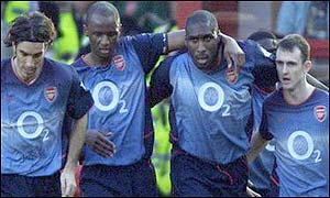 Arsenal players (from left) Robert Pires, Patrick Vieira, Sol Campbell and Francis Jeffers celebrate Campbell's opener