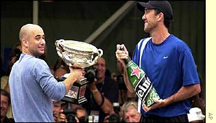 Andre Agassi celebrates with coach Darren Cahill