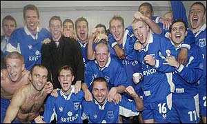 Rochdale's players celebrate in the dressing room after beating Coventry