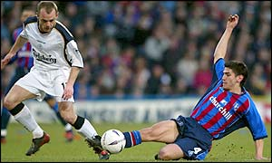 Crystal Palace's Danny Butterfield blocks the ball going to Liverpool's Danny Murphy