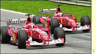 Rubens Barrichello (right) allows Michael Schumacher past on the A1-Ring's finish line
