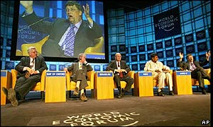 Bill Gates speaks, right, at a meeting on Science of Global Foods