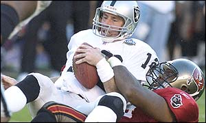 Oakland's Rich Gannon is sacked by Greg Spires in the 2003 Superbowl final