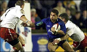 Sale's Jason Robinson takes on the Saints defence