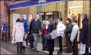 Commuters wait for rail-replacement bus