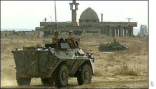 A TBAC-79 reconnaissance APC of the Romanian Army patrols in Kandahar