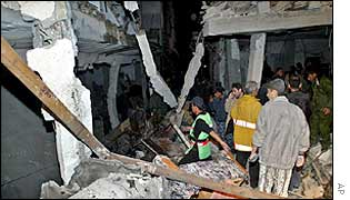 Palestinians inspect the rubble of a destroyed house in northern Gaza, 28 January 2003.
