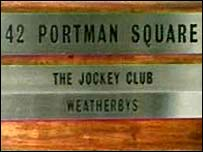 Sign outside the Jockey Club headquarters in London