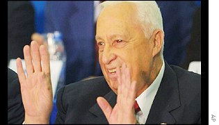 Israeli Prime Minister Ariel Sharon acknowledges the applause of party supporters in Tel Aviv