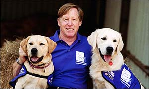 Terry Knott, chief executive of Canine Partners for Independence, with two of the charity's dogs